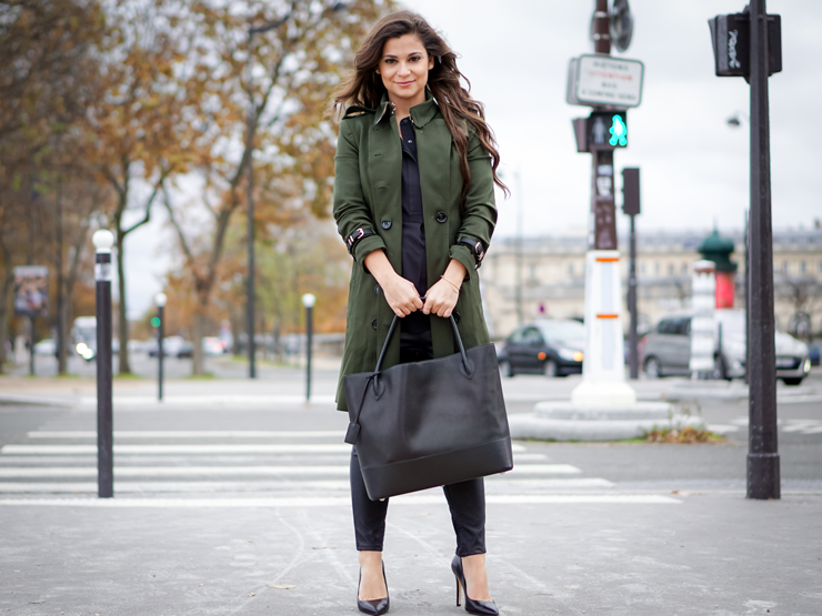 Green trench coat and black bag
