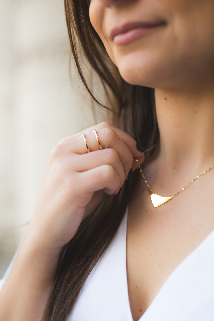 gold triangle lana necklace