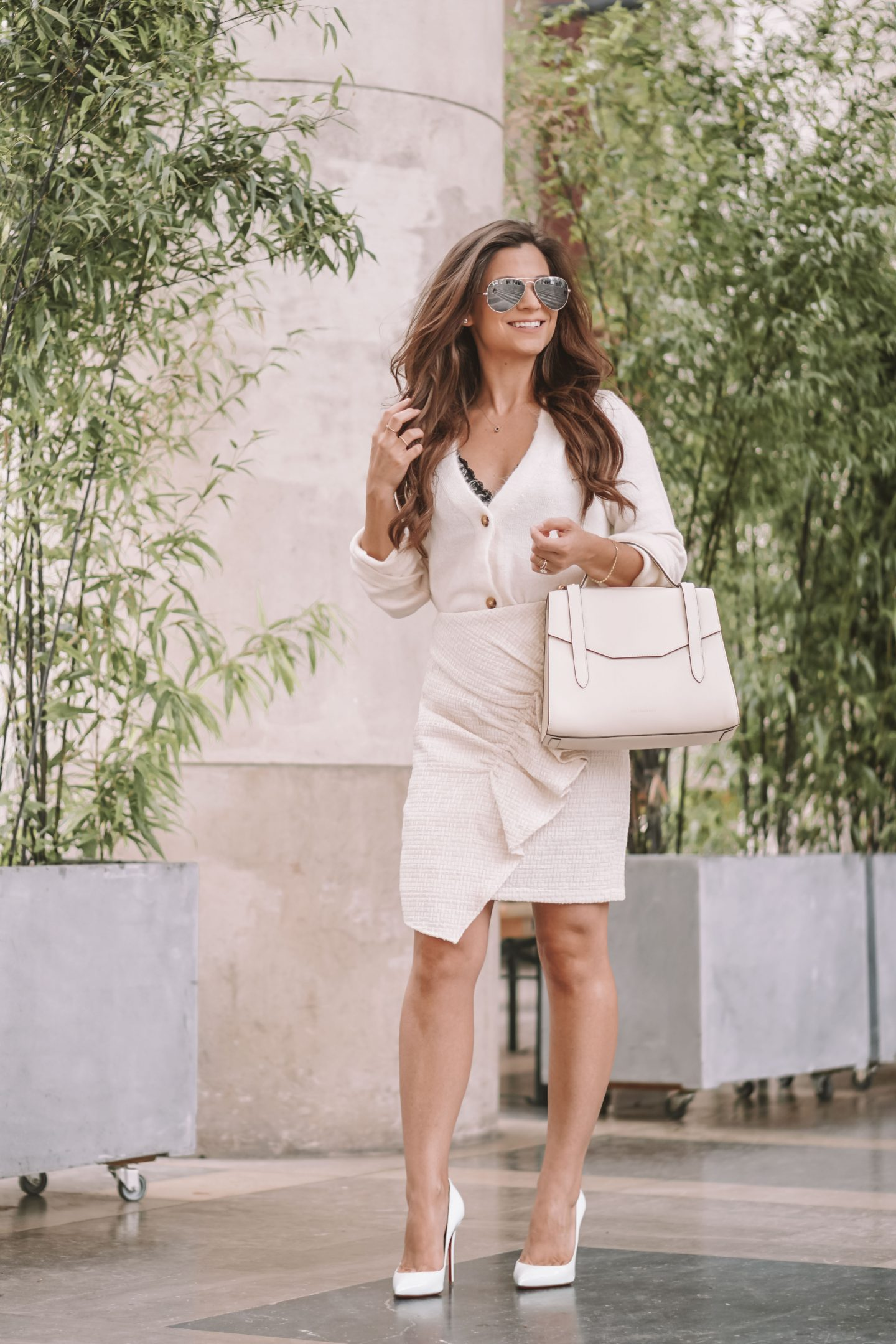 Diane Coletta petite in paris wears an all white outfit