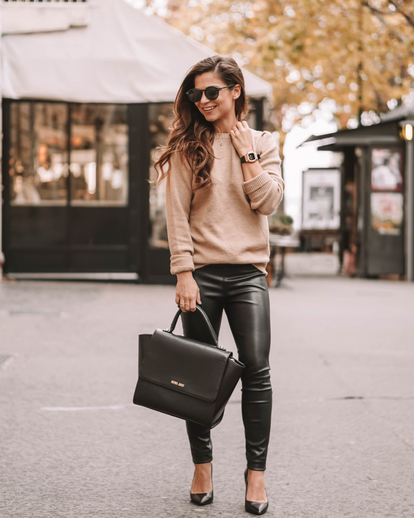 Beige sweater and leather pants