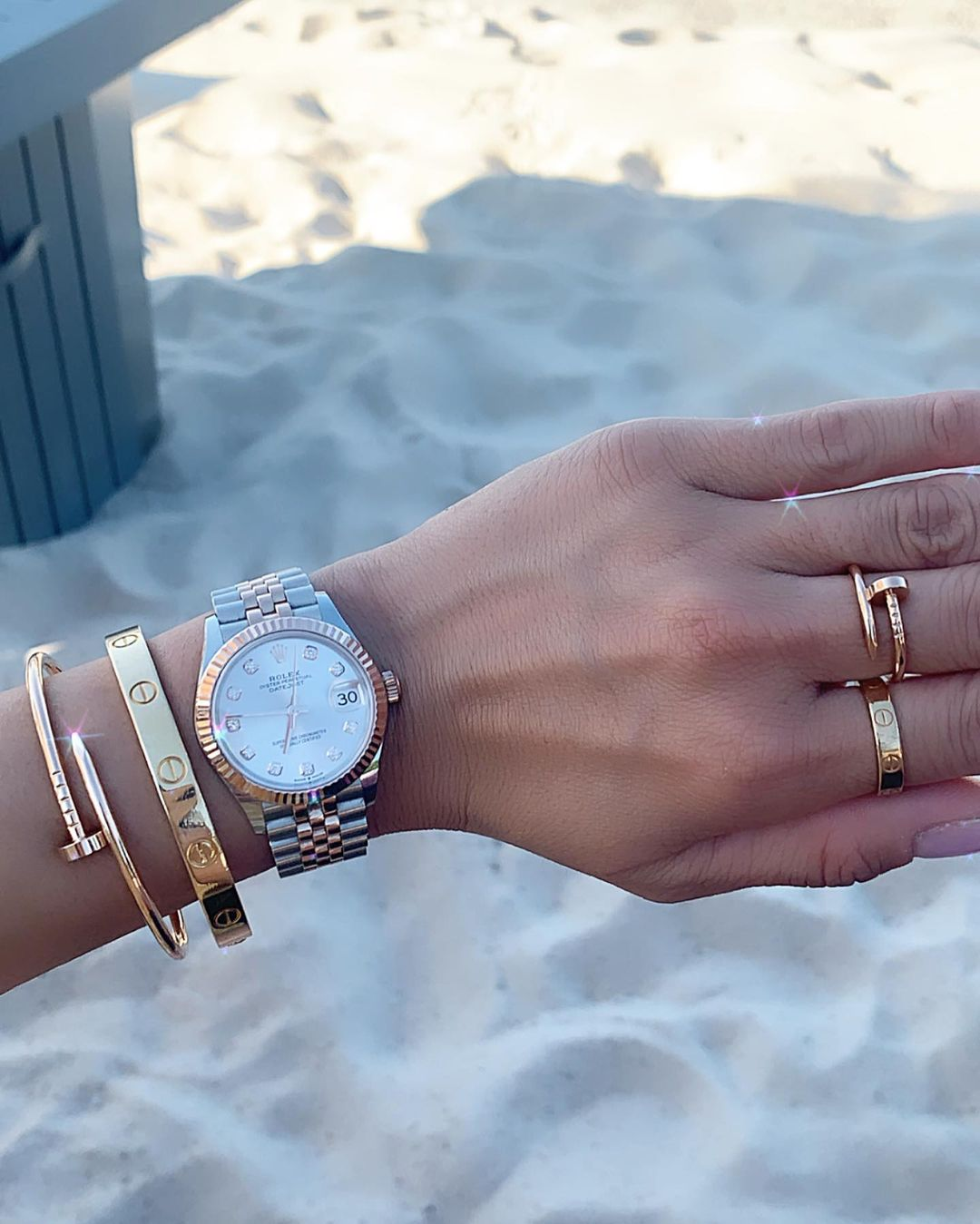 Rolex and Cartier Jewelry Stacked