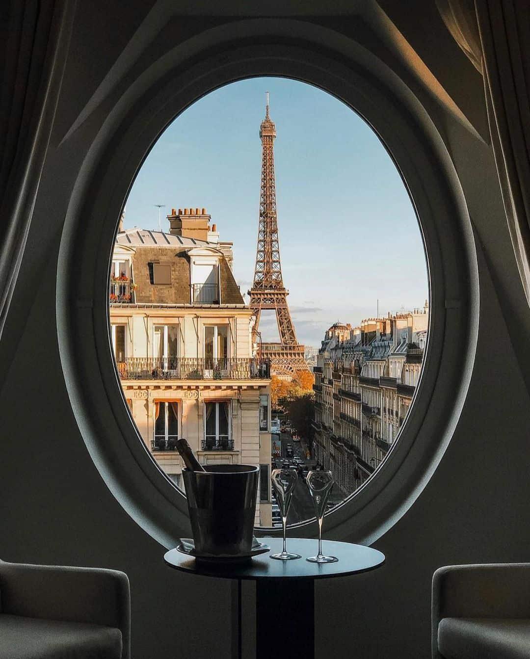 Eiffel Tower through a circle window petite in paris