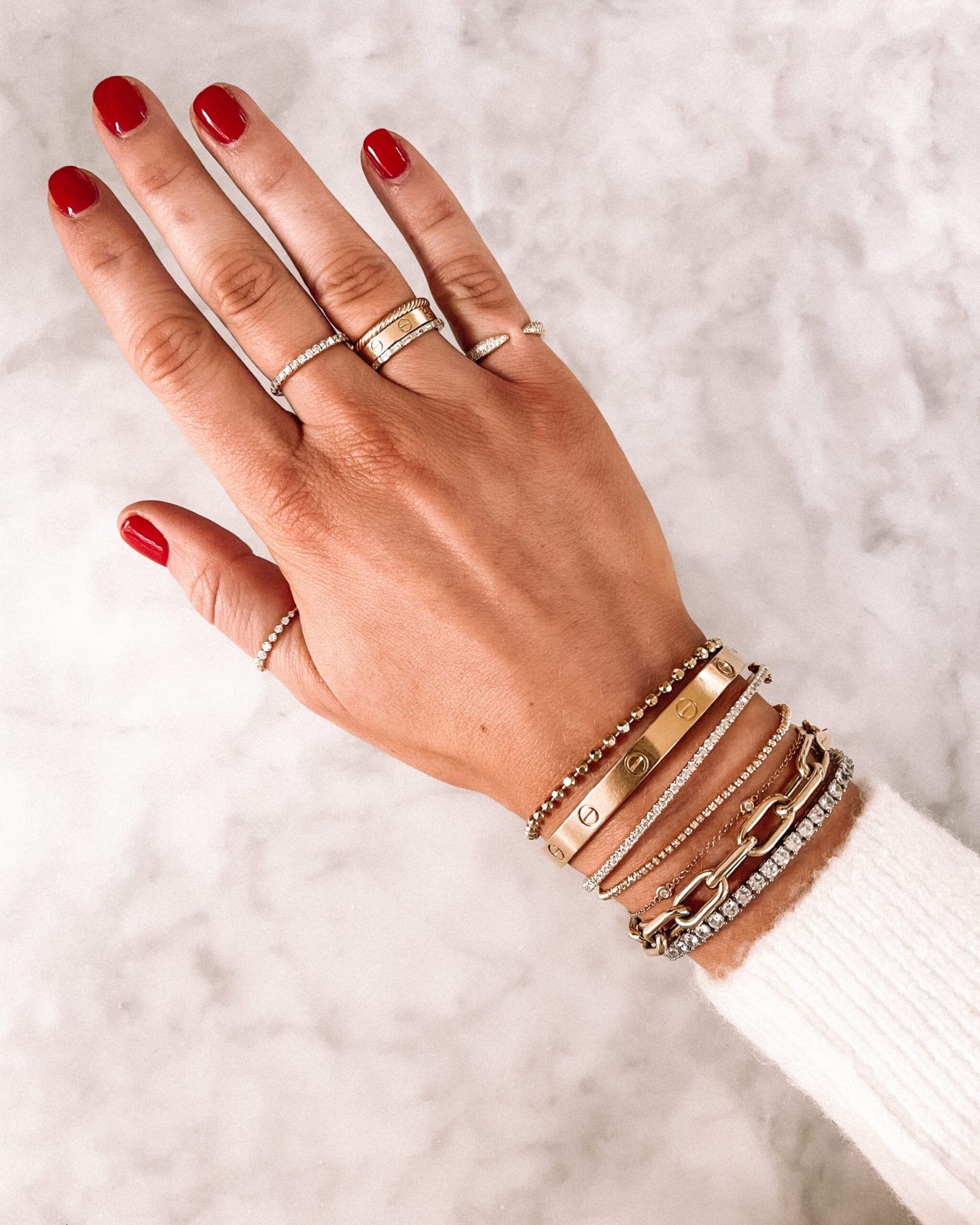 Cartier Love Ring and Bracelet styled on hand