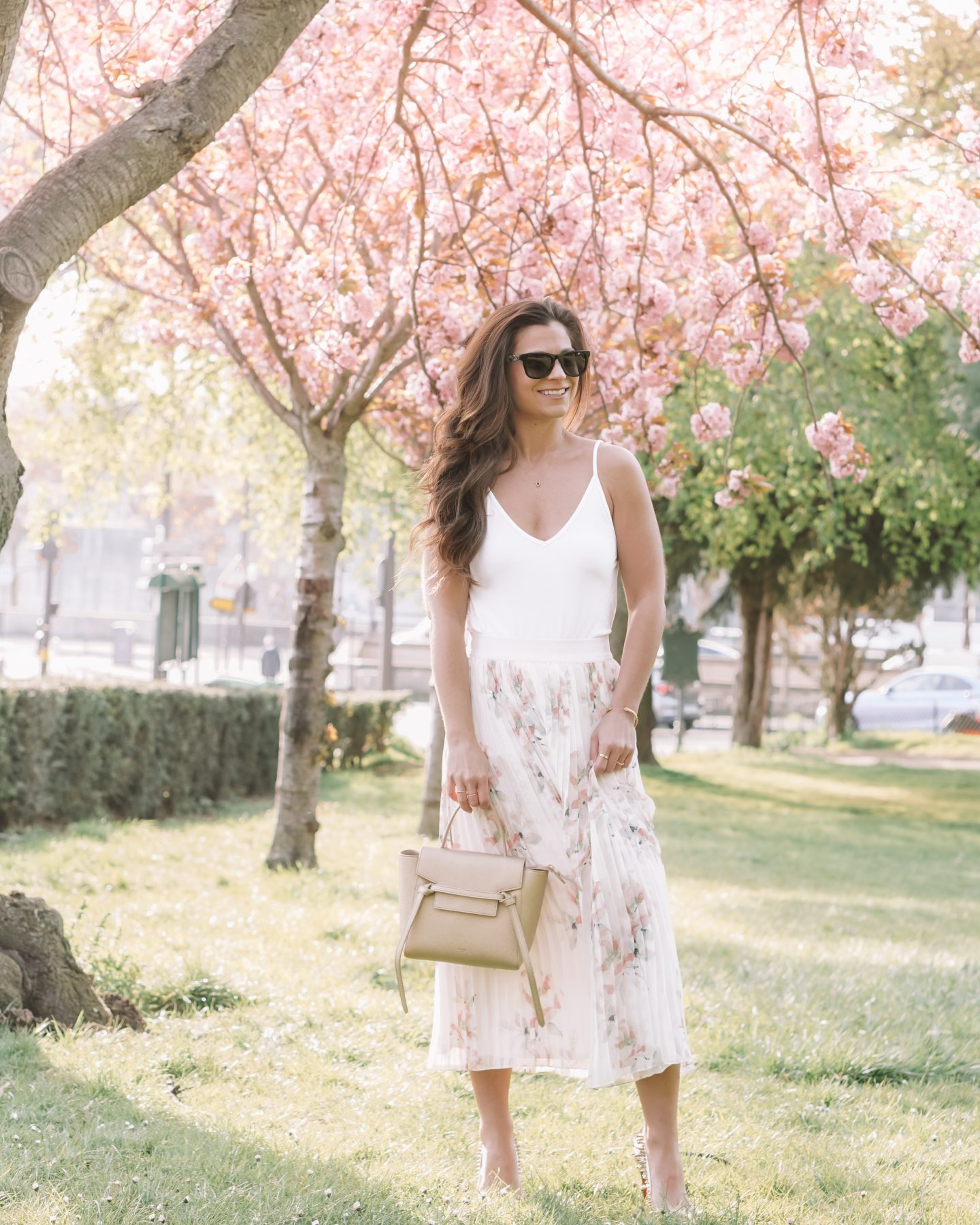 white pleated skirt outfit champagne gold celine belt bag