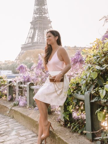 White skirt pink cami in front of the Eiffel Tower