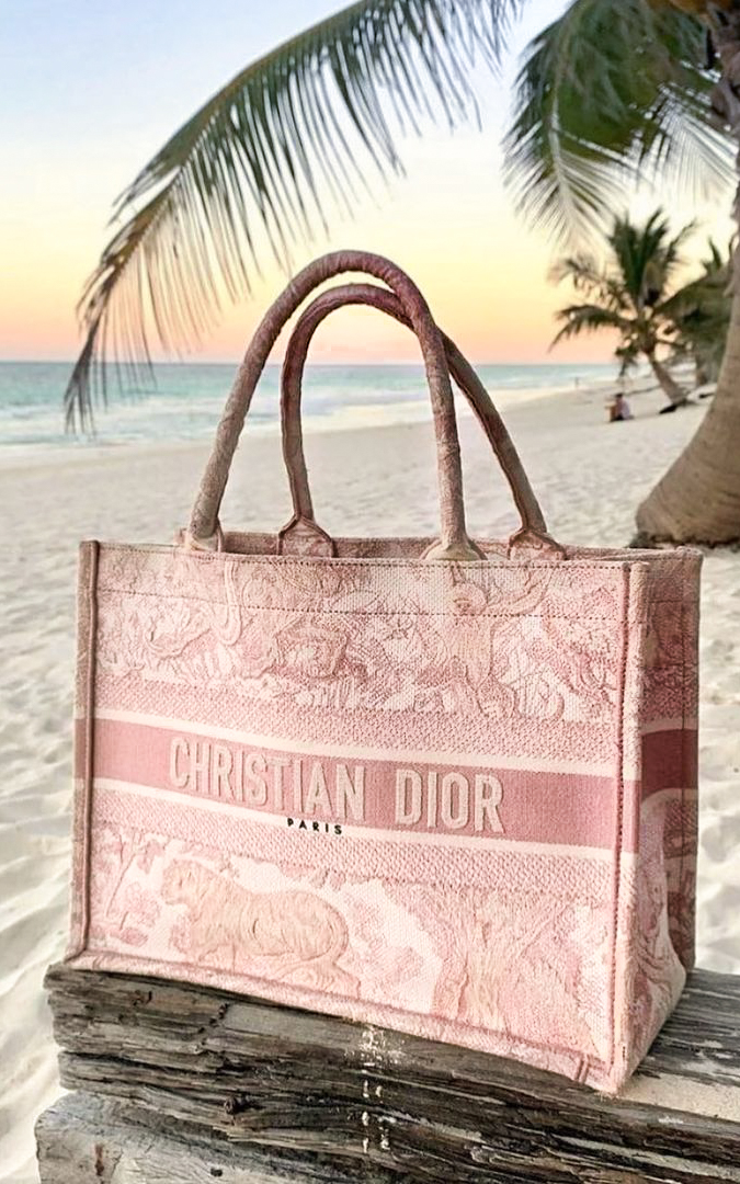 Pink Dior Book Tote Bag on the beach