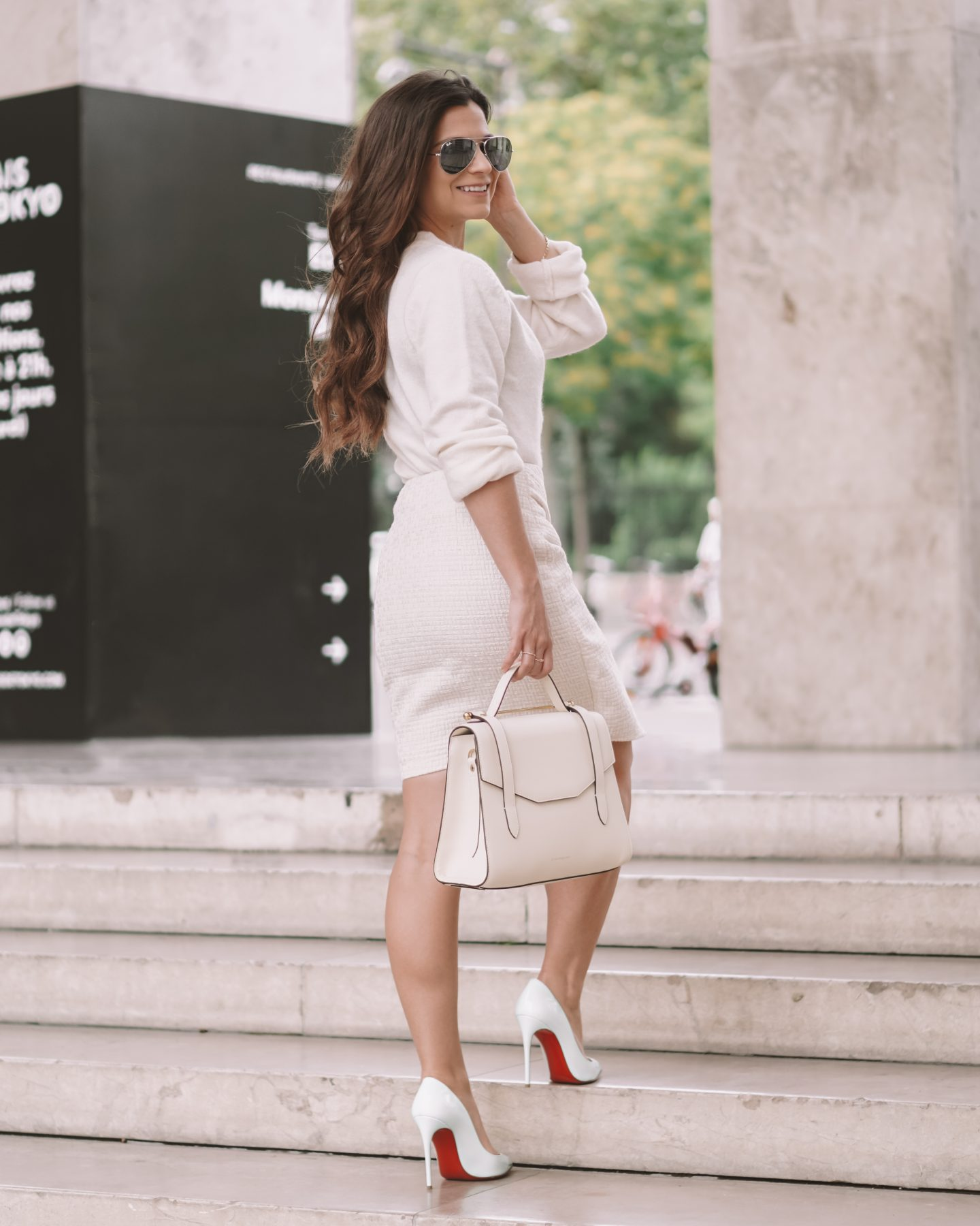 White Christian Louboutin shoes styled